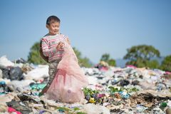 Poor children collect garbage for sale because of poverty, Junk. Recycle, Child labor, Poverty concept, World Environment Day stock image