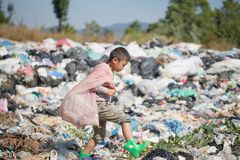 Poor children collect garbage for sale because of poverty, Junk recycle, Child labor, Poverty concept, human trafficking, World. Environment Day stock images