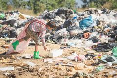 Poor children collect garbage for sale because of poverty, Junk recycle, Child labor, Poverty concept, human trafficking, World. Environment Day royalty free stock image