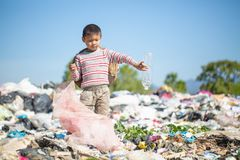 Poor children collect garbage for sale because of poverty, Junk recycle, Child labor, Poverty concept, human trafficking, World. Environment Day stock photography