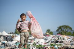 Poor children collect garbage for sale because of poverty, Junk recycle, Child labor, Poverty concept, World Environment Day.  stock image