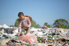 Poor children collect garbage for sale because of poverty, Junk recycle, Child labor, Poverty concept, World Environment Day.  royalty free stock image