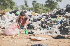 Poor children collect garbage for sale because of poverty, Junk recycle, Child labor, Poverty concept, World Environment Day.  stock photos