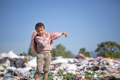 Poor children collect garbage for sale because of poverty, Junk recycle, Child labor, Poverty concept, World Environment Day stock image
