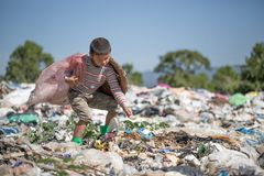 Poor children collect garbage for sale because of poverty, Junk recycle, Child labor, Poverty concept, human trafficking, World. Environment Day stock photo