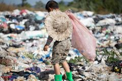 Poor children collect garbage for sale because of poverty, Junk recycle, Child labor, Poverty concept, World Environment Day.  royalty free stock photo