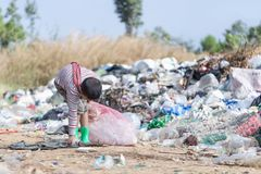 Poor children collect garbage for sale because of poverty, Junk recycle, Child labor, Poverty concept, World Environment Day.  stock images
