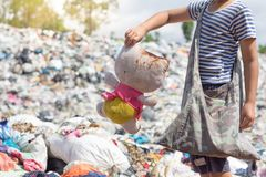 Poor children collect old dolls from garbage dumps, the concept. Of pollution and the environment,World Environment Day Stock Images