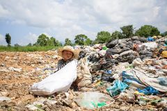Poor children collect and sort waste for sale, concepts of poverty and the environment.  stock images