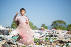 Poor children collect and sort waste for sale, concepts of poverty and the environment.  stock photos