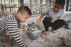 Poor children are forced to work construction, Violence children royalty free stock photo