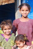 Poor Children in India. Three young girls pose for the camera in a slum area of Kurnool, in Andhra Pradesh in India. Useful for news stories about poor chidlren Royalty Free Stock Images