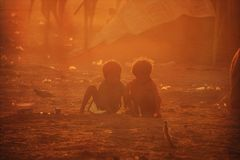 Poor children from India. Two poor and dirty children from the Indian city of Pushkaror Pushkar Mela play on the dusty street.Pushkar Mela, is a colorful and Royalty Free Stock Photos