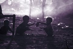 Poor children from India. Two poor and dirty children from the Indian city of Pushkaror Pushkar Mela play on the dusty street.Pushkar Mela, is a colorful and Royalty Free Stock Image