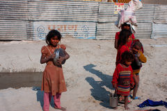 Poor children on an indian street. Unidentified poor children looking for a food during the biggest festival in the world - Kumbh Mela, on January 26, 2013 in Stock Photo