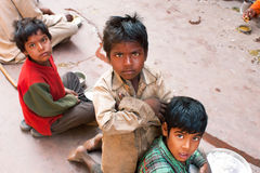 Poor children play on the street in India. Royalty Free Stock Photo