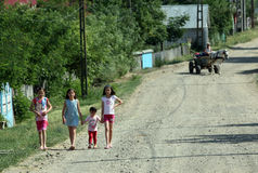 Poor children on the road. In a romanian village. One major problem in Romania is that, because of poverty, parents are forced to leave the country in search of royalty free stock image