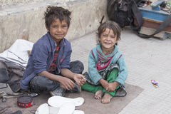 Poor children on the street in Leh, Ladakh, India Royalty Free Stock Photos