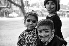 Poor children at a traffic crossing in New Delhi, India Royalty Free Stock Photos
