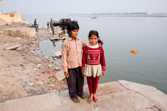 Poor children walk on the banks of the River Ganga Royalty Free Stock Image