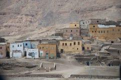 Poor clay shacks in the desert Stock Images