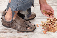 Poor and coins Stock Photography
