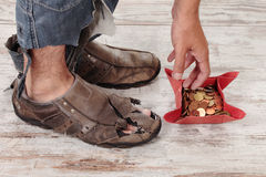 Poor and coins Royalty Free Stock Photos