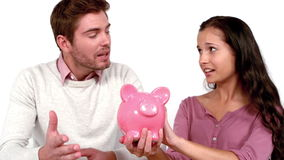 Poor couple with moving box and piggy bank stock footage