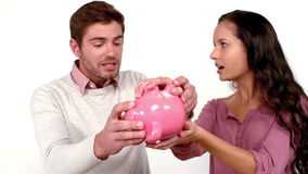 Poor couple with moving box and piggy bank stock video