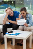 Poor couple reading unpaid bills Royalty Free Stock Photo