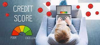 Poor Credit Score with man using a laptop. In a modern gray chair royalty free stock photo