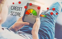 Poor Credit Score with man using a tablet. In a chair stock photos
