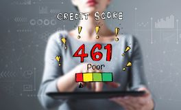 Poor credit score theme with woman using a tablet stock photography