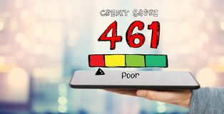 Poor credit score theme with tablet computer stock images