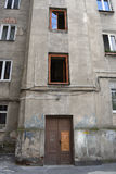 Poor depressive house. Old depressive partially damaged house in one of the poorest and dangerous district of Warsaw. Location: Praga district, Warsaw, Poland Royalty Free Stock Photo