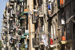 Poor district. Colorful balconies background in poor Latin district of old Barcelona, Spain; sharp focus in middle part royalty free stock photos