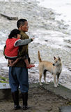 Poor Dong Old man, child and dog in old village, C Stock Images
