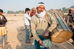 Poor drummer play music outdoor in Gaya, India Royalty Free Stock Image