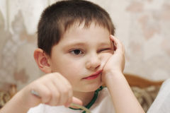 Poor eater. Little poor eater boy at dinner closeup photo selective focus royalty free stock photos