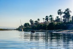 Poor egyptian fishermen in boat on the Nile river stock photos