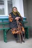 Poor elderly woman Stock Images