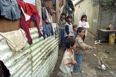 Poor existence of Argentine children in a slum. ARGENTINA, city, capital of Buenos Aires: poor children in their neighborhood in the slum Villa Jardin. The royalty free stock images