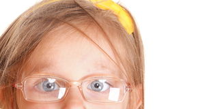 Poor eyesight girl wearing glasses isolated on white Royalty Free Stock Photos