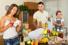 Poor family with bags of food Royalty Free Stock Image