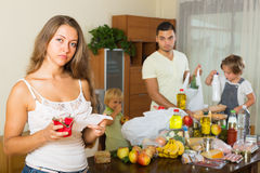 Poor family with bags of food. Upset women with receipt from store, family brought food home stock photos