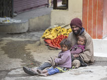Poor family of beggars on the streets in India Royalty Free Stock Images