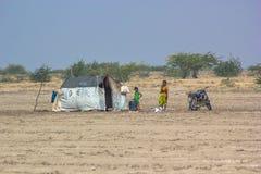 A poor family in desert Stock Photo