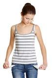 Poor female caucasian teen with empty pockets. Stock Photos