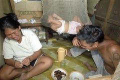 Poor Filipino family living in slum Packwood, Manila royalty free stock images