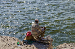 A poor fisherman trying his luck Royalty Free Stock Images